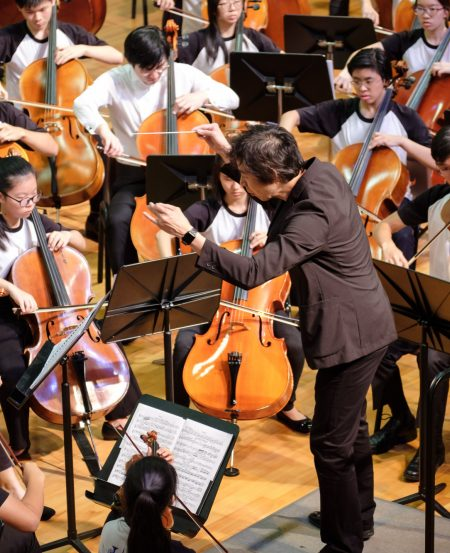 Principal Conductor Joshua Tan leds the youth orchestra
