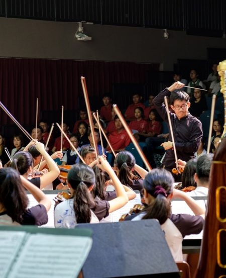Associate Conductor Lin Juan and the SNYO