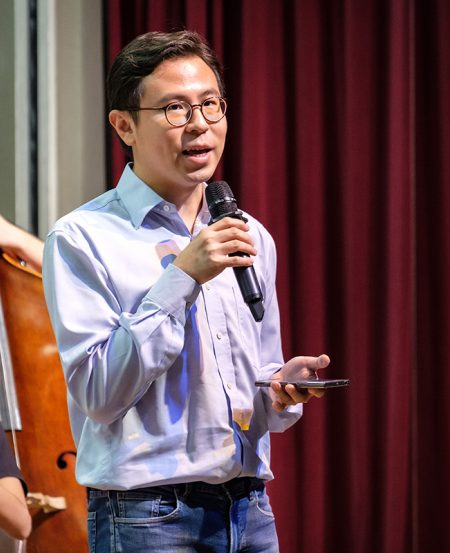 Presenter Mr Isaac Lee explains some of the plot lines of the opera pieces being performed