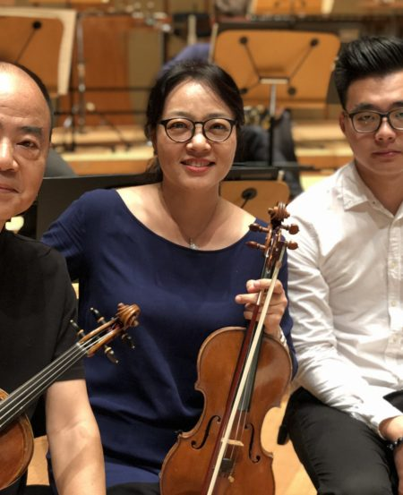 President's Young Performers concert soloist Kong Xianlong (right, pictured here with his parents) comes from a musical family. Xianlong began violin lessons with his grandfather when he was four.