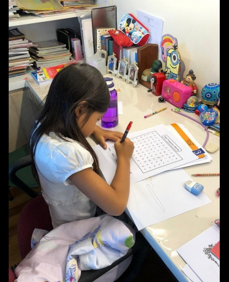 Elaine's children work in separate rooms for their home-based learning.