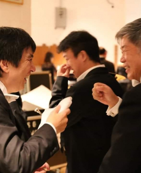 "Sharing a post-concert moment with former SSO music director Lan Shui (left). ""Choo Hoey gave me my first break by inviting me to join the SSO. He was very exacting. So was Lan Shui – but both conductors had quite different working styles, which helped me improve tremendously."""