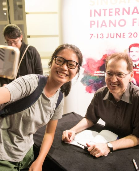 A happy patron with Denes Varjon during his autograph session at the Victoria Concert Hall. (Photo Credit: Jack Yam)