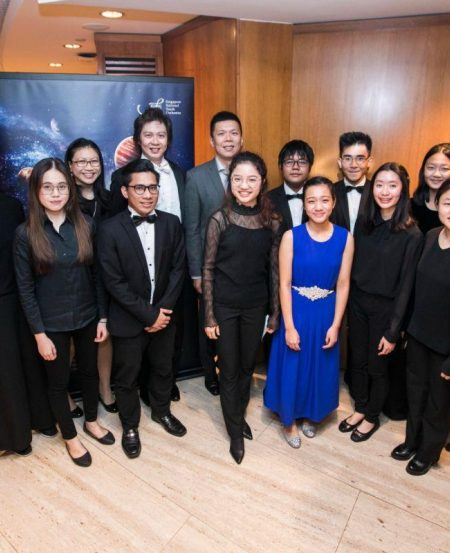 Alyssa Goh (in blue) with members and management of SNYO at the concert reception