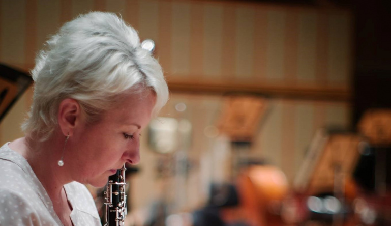 What do titanium and a garage have to do with SSO Principal Oboe, Rachel Walker?
