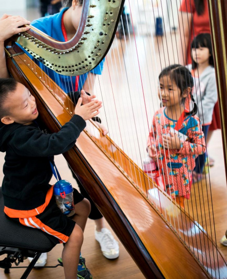 Children get to have a hands-on experience with the instruments.