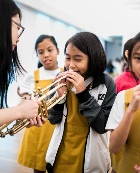 """An instrument """"petting zoo"""" where you can try playing different instruments."""