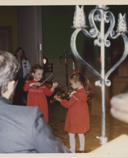 Rachel with her sister Sarah at a Christmas party in 1980