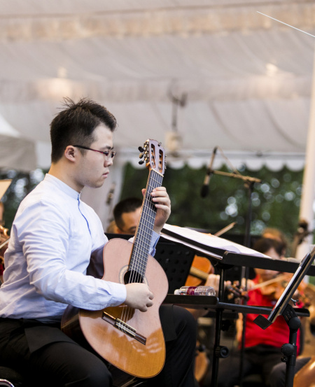 Kevin Loh performed Concerto for Guitar No.1 in D: III. and Introduction & Fandango.    © Chrisspics photography