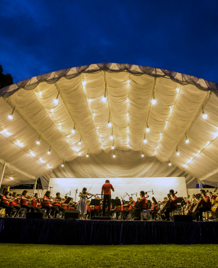 The Singapore Symphony Orchestra performed at the Istana 150 Commemorative Event. As the finale to a year-long anniversary celebration, the Istana grounds were opened to members of public for the first time at night, on 6 October 2019. All proceeds of the ticketed event were donated to the President's Challenge.    © Chrisspics photography