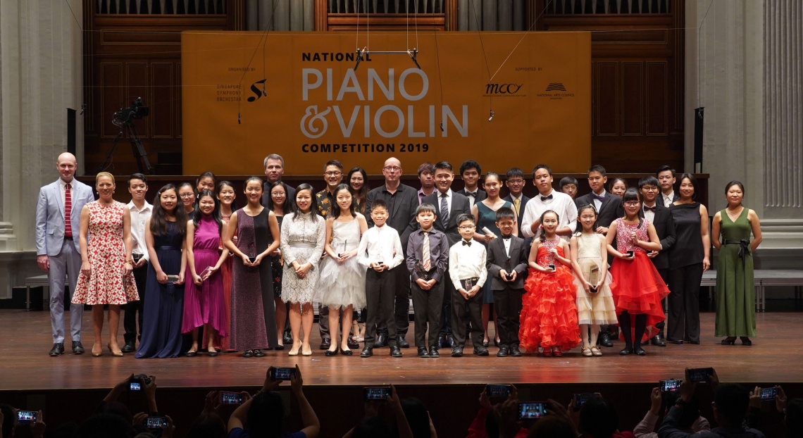A gathering of SSO musicians and their families with Choo Hoey and Mrs Alexandra Choo