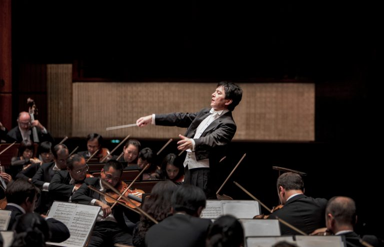 Violinist He Ziyu with the SSO led by Maestro Choo Hoey
